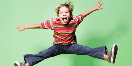 Young boy jumping in mid-air